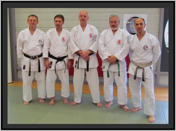 Au centre, les Canadiens, entourés des experts J. Faieff et A. Hauwaert